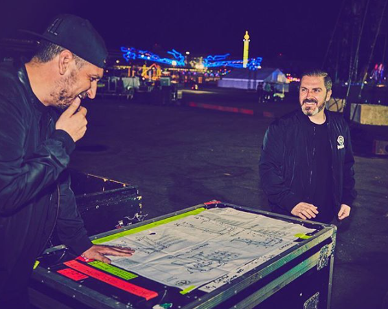 Pasquale Rotella supervising blue prints for music festival