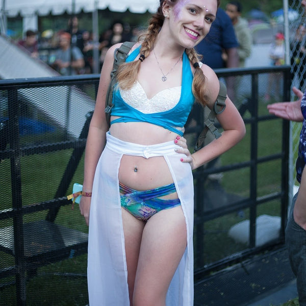 Girl Wearing Aqua Matching Rave Set and white lace maxi skirt