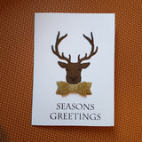 Christmas greeting card - stag with bow