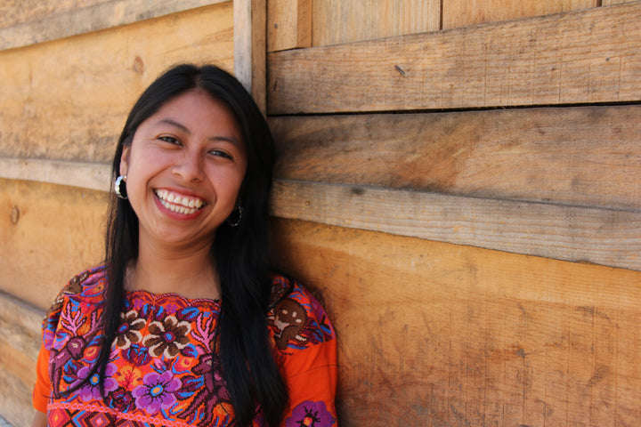 Guatemalan artisan, Veronica, smiles because she is being empowered.