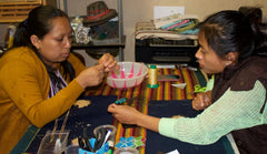 Linda making  anecklace with Chonita