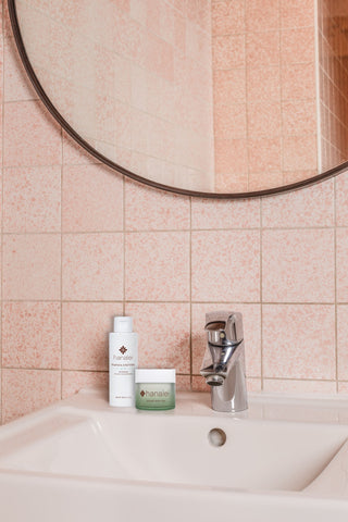 Hanalei Company Botanical Skincare Products shown in bathroom