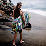 "Protect your surfboard while traveling to your favorite surf spot with this handwoven surfboard sock. Featuring a tight ribbed weave and a drawstring closure system, this surfboard bag is durable and enables you to quickly get your surfboard in or out.   Póvoa surfboard day bags are handmade in Póvoa, Portugal. The purchase of this surfboard bag supports small independent artisans.   Fits boards up to 22"" wide Fits longboards and shortboards (please choose exact size when ordering) For light travel  Drawstr"