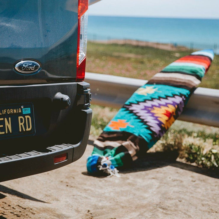 "Turquoise Aztec Baja Surfboard bag features a tight thick weave adding cushion for your board during day use. The opening is constructed with a drawstring closure system for easy and quick access.  Fits surfboards up to 6'3"" long"