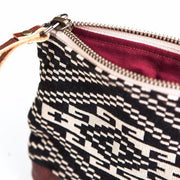 Hand-made clutch featuring a unique aztec design.  Black and White color. The bottom of the clutch is made out of hand-dyed, 100% genuine cow hide, adding durability and style. The interior of the clutch is lined with 100% cotton.