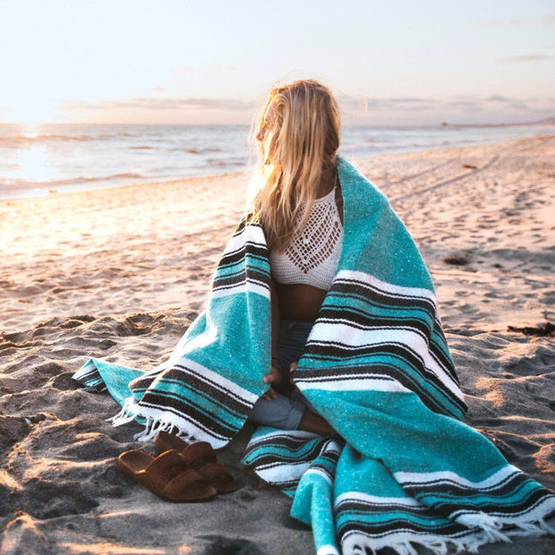 "Handmade Mexican Yoga Blanket in Mint  Our Mexican Baja Blankets are thick and heavy weighted making them excellent for cozy throws for your bedding or sofa. In yoga practice they can be used as props and small bolsters and as a medium weight cover during savasana or meditation. Or bring to the beach for you sunbathing mermaids.  Features include:  Extra Large Size: 78"" x 54"" Cotton Acrylic Polyester Blend--Machine Washable Soft and Thick Sized for queen bed (80""x 60"") and double bed (74"" x 54"") Heavy Weigh"