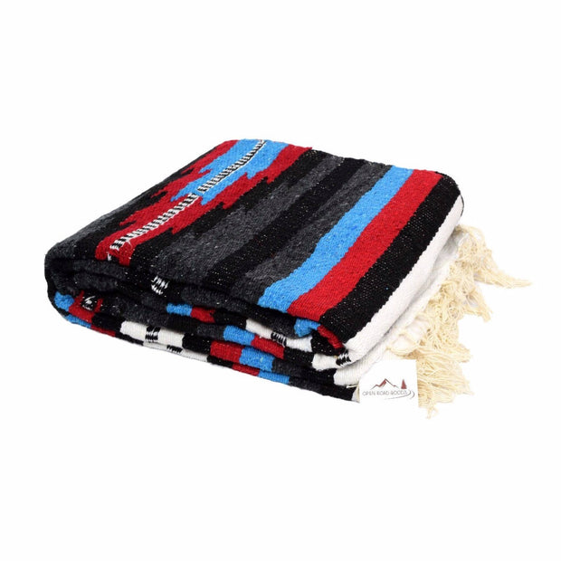 Baja Mexican Thunderbird Yoga Blanket in our Custom Baja Aztec Design. Bright red, electric blue, black, white, and deep gray. Our Mexican Baja Blankets are thick and heavy weighted making them excellent for cozy throws for your bed or sofa. In your yoga practice they can be used as props and small bolsters and as a medium weight cover during savasana or meditation.