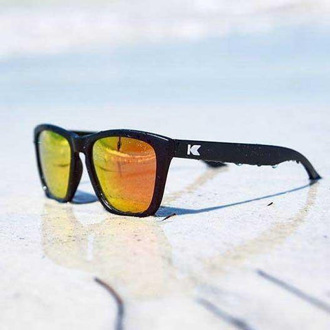sunglasses matte black orange lenses