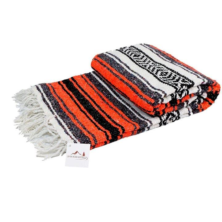 "Orange and Black Mexican Falsa Blanket. The La Playa Yoga blanket is designed in the traditional Mexican ""Falsa"" style. They offer a softer and looser weave, making them ideal for use as small props during yoga practice. The La Playa blanket is a good option for a lighter weight blanket for those long beach walks.    Large Size: 73"" x 48"" Cotton Acrylic Polyester Blend Machine Washable Extra Soft Loose Weave Handmade Sized for queen bed (80""x 60"") and double bed (74"" x 54"") Great as a beach blanket, picnic"