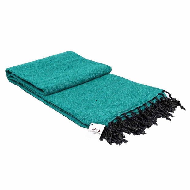green teal meditation blanket with black tassles