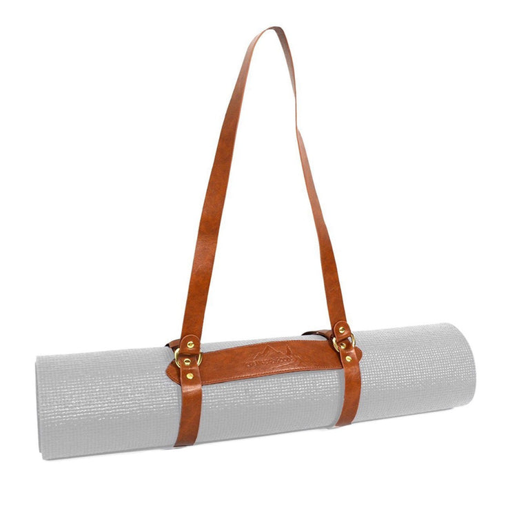Yoga mat carrying strap made from vegan leather. Size it to your mat or blankets with adjustable buckles. Will fit average sized yoga mats and most blankets.  Great under $20 gift for him or her.