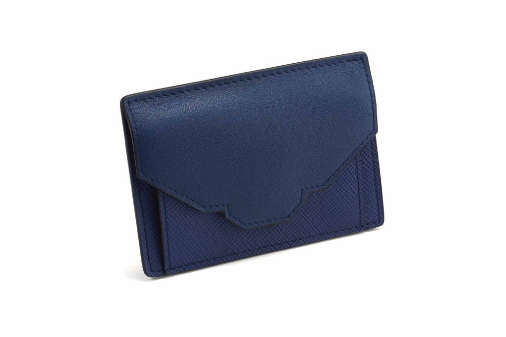 Image of a luxury coin and cash holder in Regal Blue. Cute and petite, the Emm coin and cash holder holds the little things that gets lost at the bottom of a handbag. It is also a quick and easy grab purse to hold a few cash, coins and card for heading down the shops. Alternatively, it is safe to hold smaller jewelry items such as earrings, necklaces or rings. The Emm coin and cash holder is designed with a slightly padded front flap opening inspired by the Revelry handbag prime collection. The bottom side