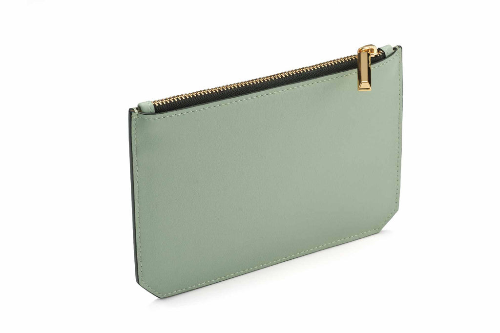 Image of luxury classic style pouch in Desert Sage. Named as the Enn Pouch, this item is part of Revelry luxury small leather goods collection. The Enn Pouch is designed based on the prime handbag collection with geometrical cuts on the bottom edges of the pouch. Compact like a mini wallet, the Enn pouch design to replace most items stored in a regular-size wallet and is also useful for storing jewelry and makeup. The Enn Pouch is a complimentary accessory to use with any Revelry handbag. Useful during ligh