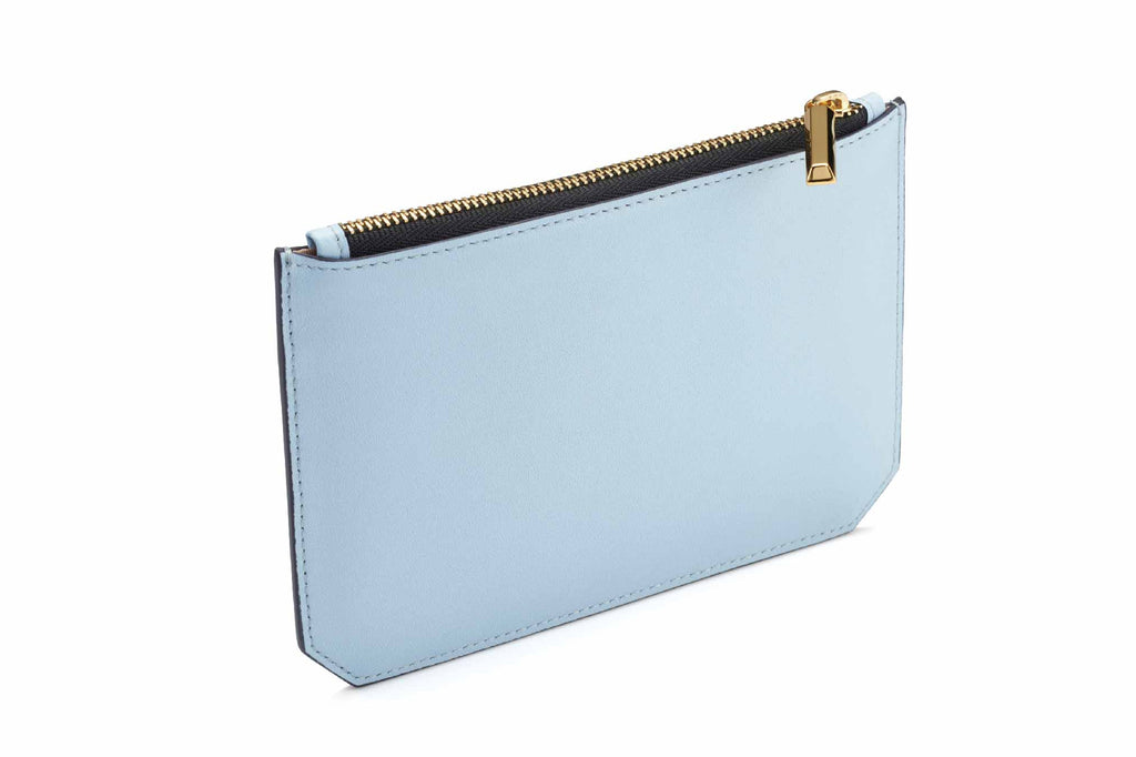 Image of luxury classic style pouch in Dusty Blue. Named as the Enn Pouch, this item is part of Revelry luxury small leather goods collection. The Enn Pouch is designed based on the prime handbag collection with geometrical cuts on the bottom edges of the pouch. Compact like a mini wallet, the Enn pouch design to replace most items stored in a regular-size wallet and is also useful for storing jewelry and makeup. The Enn Pouch is a complimentary accessory to use with any Revelry handbag. Useful during light