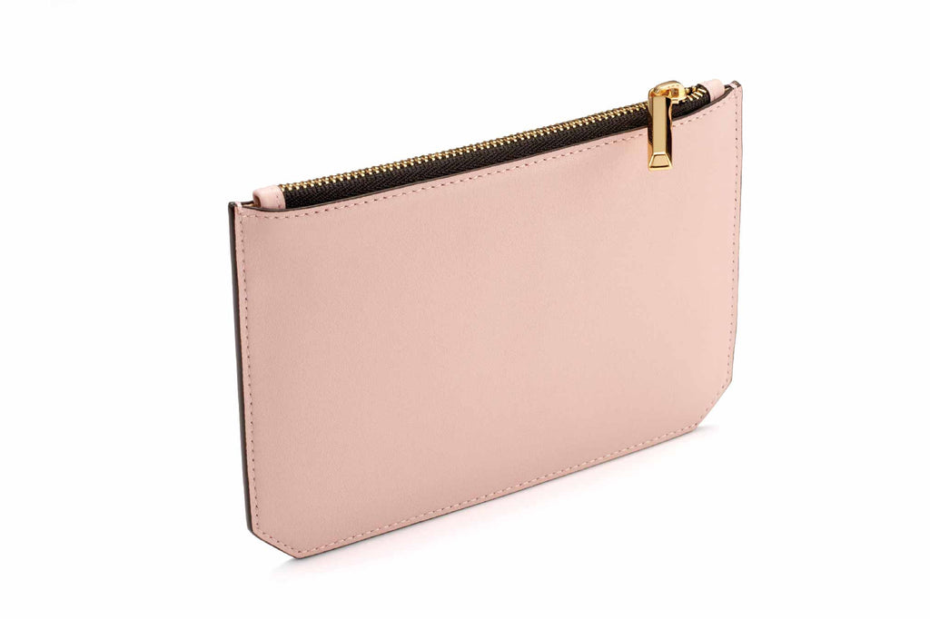 Image of luxury classic style pouch in Dusty Pink. Named as the Enn Pouch, this item is part of Revelry luxury small leather goods collection. The Enn Pouch is designed based on the prime handbag collection with geometrical cuts on the bottom edges of the pouch. Compact like a mini wallet, the Enn pouch design to replace most items stored in a regular-size wallet and is also useful for storing jewelry and makeup. The Enn Pouch is a complimentary accessory to use with any Revelry handbag. Useful during light
