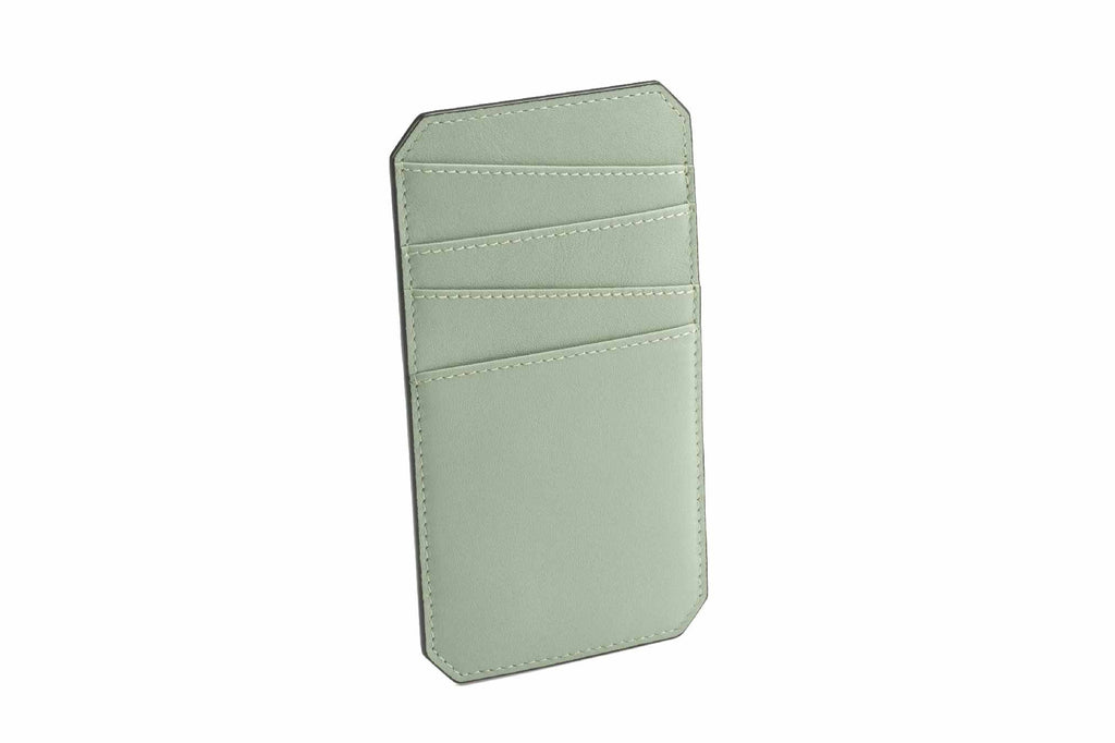 Image of a luxury leather cardholder in Desert Sage. This palm size accessory is an addition to Revelry's small leather goods collection. The NAME Cardholder was specially designed to hold all your cards in one place, making it easy to access cards without trying to search through a wallet or misplacing them. All the trouble about carrying cards around is resolved by this simple piece of accessory, designed in a vertical structure with fun style asymmetrical slots to store all your important cards. The NAM