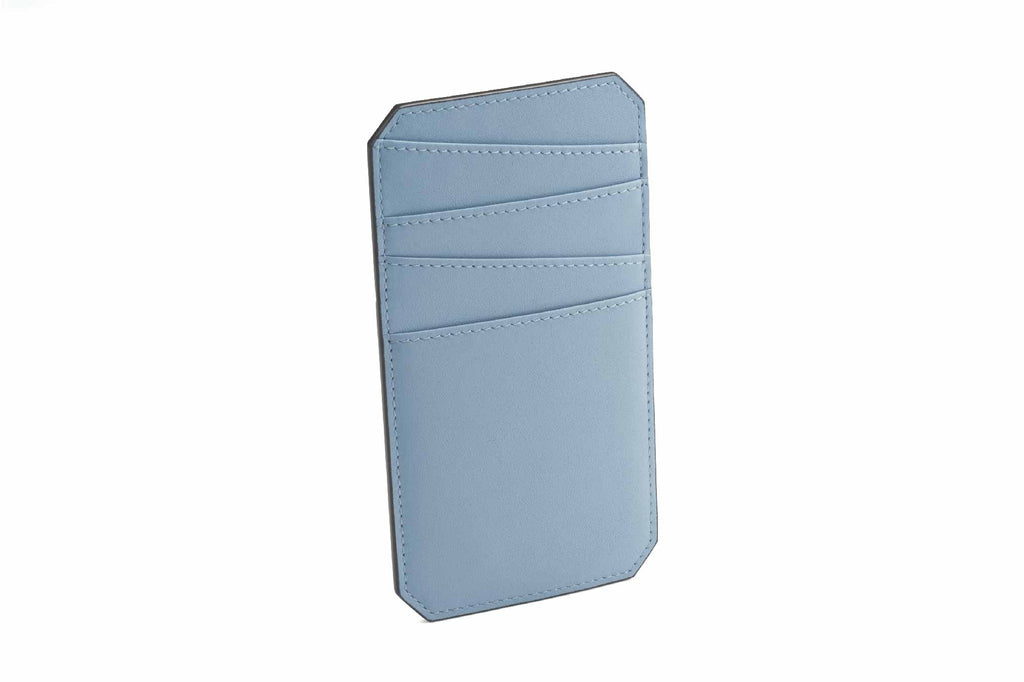 Image of a luxury leather cardholder in Dusty Blue. This palm size accessory is an addition to Revelry's small leather goods collection. The NAME Cardholder was specially designed to hold all your cards in one place, making it easy to access cards without trying to search through a wallet or misplacing them. All the trouble about carrying cards around is resolved by this simple piece of accessory, designed in a vertical structure with fun style asymmetrical slots to store all your important cards. The NAME