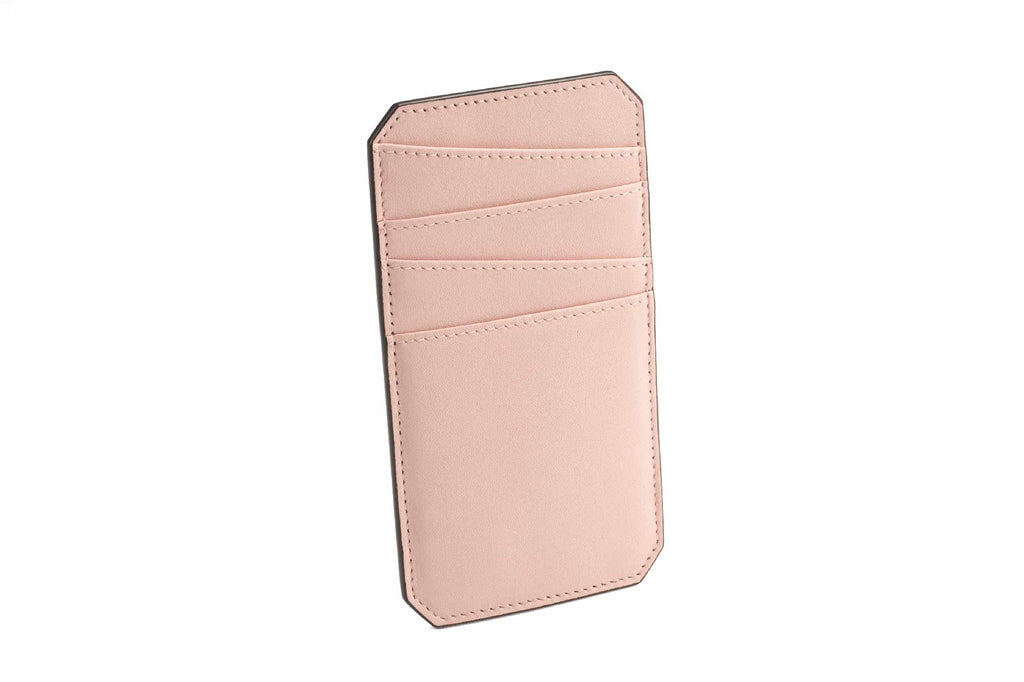 Image of a luxury leather cardholder in Dusty Pink. This palm size accessory is an addition to Revelry's small leather goods collection. The NAME Cardholder was specially designed to hold all your cards in one place, making it easy to access cards without trying to search through a wallet or misplacing them. All the trouble about carrying cards around is resolved by this simple piece of accessory, designed in a vertical structure with fun style asymmetrical slots to store all your important cards. The NAME