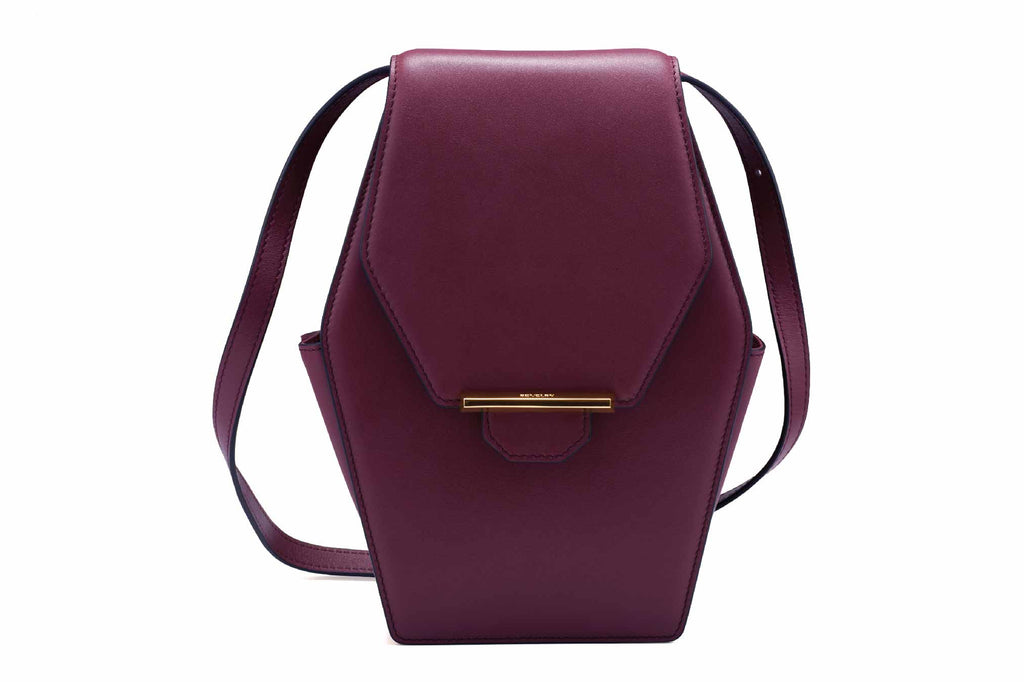 Image of a luxury medium style diamond shoulder handbag in Sangria. Nothing speaks louder than the shape of this handbag; inspired by a diamond- beautiful and rare,  the Rue Diamond is Revelry's iconic style handbag. It is also the most unique piece in the range because of it's cut. Like an expensive diamond cut, the external front and back body of the Rue Diamond handbag is cut as one whole piece for a cleaner and luxury finish. The Rue Diamond has a distinctive style, edgily playful yet elegant. A sure wo