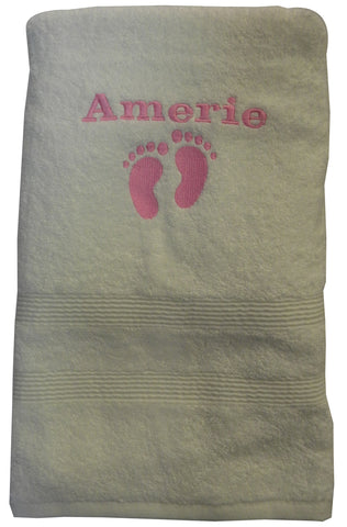Personalised baby bath towel with footprints and a name