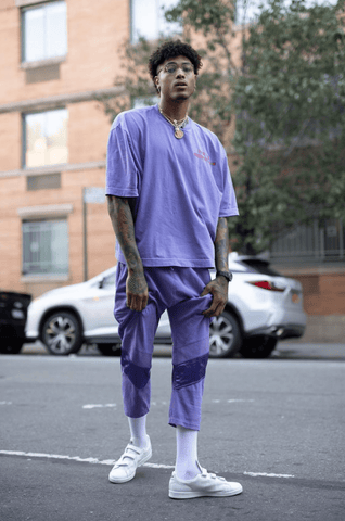 Kelly Oubre Jr. in a purple outfit