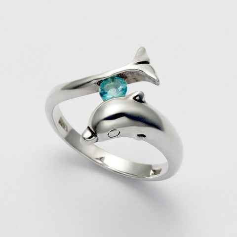 Dolphin Holding Blue Topaz Ring