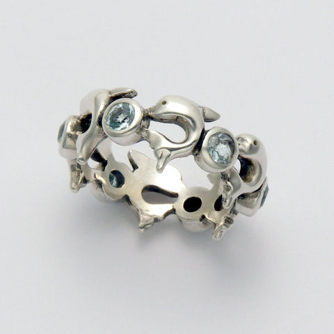 Dolphin Mamba with Blue Topaz Ring