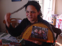 Lisa with pic of kids on wooden frame.