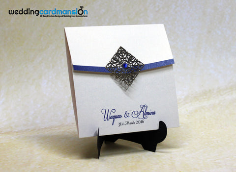 White square wallet style wedding invitation with metal embellishment, rhinestone and insert.Personalised with names.
