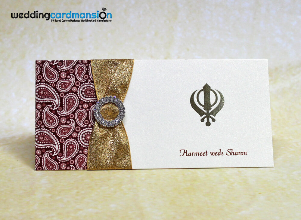 Sikh folded wedding invitation with foiling, ribbon and diamanté slider. WC311