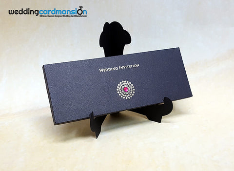 Black laser cut box style wedding invitation with foiling and rhinestone. WC343