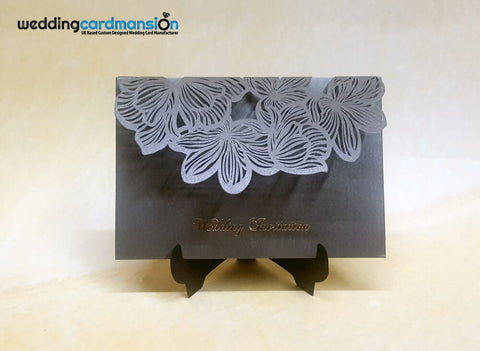 Exquisite Floral Tri-fold Laser Cut Pocket Wedding Invitation with foiled wedding invitation. This card comes complete with 1 metallic shimmer insert and choice of matching envelope.