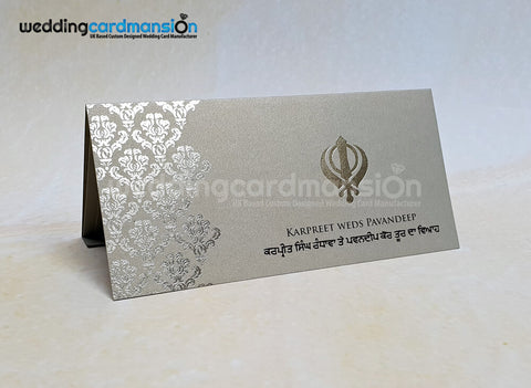 Folded Damask foiled Khanda wedding invitation. WC420