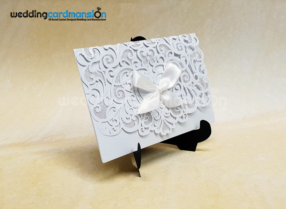 White Shimmer Bow Laser Cut Invitation. WC444