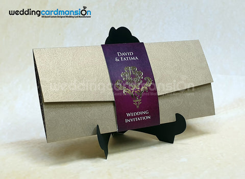 Gold die cut folded wedding invitation with foiled belly wrap