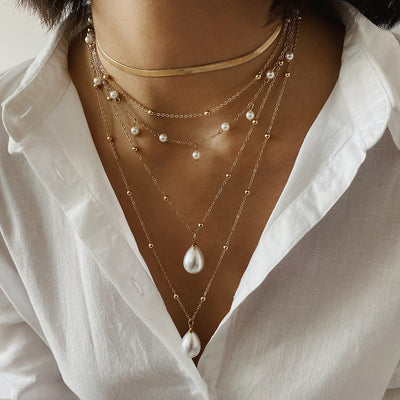 Five Chain Layer Gold and Pearl Necklace