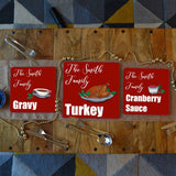 3 personalised Christmas placemats with turkey, gravy and cranberry sauce illustrations on them