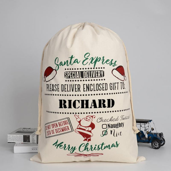 A personalised cream cotton Santa sack with red, green and black lettering and a vintage style design which is customised with a child's name.