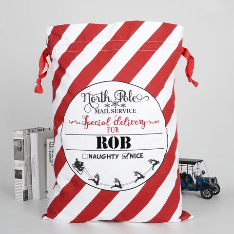 A personalised Christmas sack with red and white stripes and a personalised name in black lettering