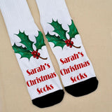 "Personalised Christmas socks with a holly leaf pattern and the text ""Sarah's Christmas Socks"" in red lettering"