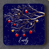 "A dark blue personalised square coaster with a winter tree design, the coaster is personalised with the name ""Emily"""