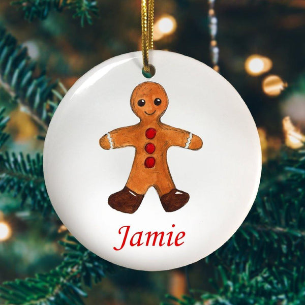 A personalised Christmas decoration with a gingerbread man printed onto it