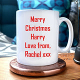 "An image showing the reverse of the mug with a message printed on it in red text. The message reads ""merry Christmas Harry love from Rachel xxx"""