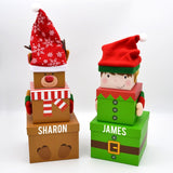 Personalised Christmas gift boxes with reindeer and elf designs.