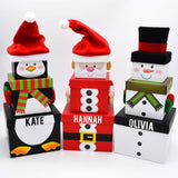 Personalised Christmas gift boxes with Santa, snowman and penguin designs.