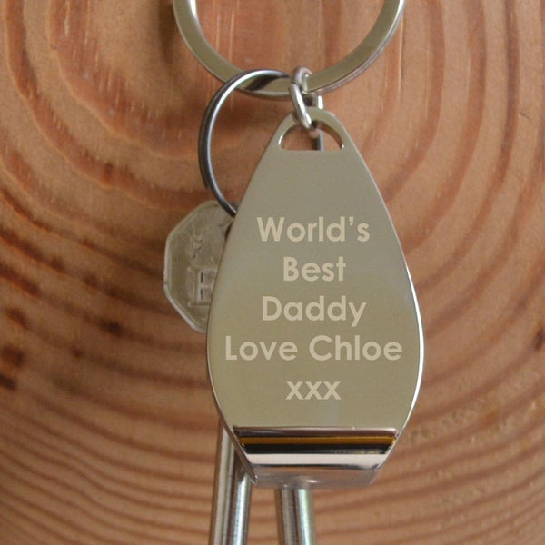 "a personalised metal bottle opener keyring engraved with the message ""world's best daddy, love Chloe"""