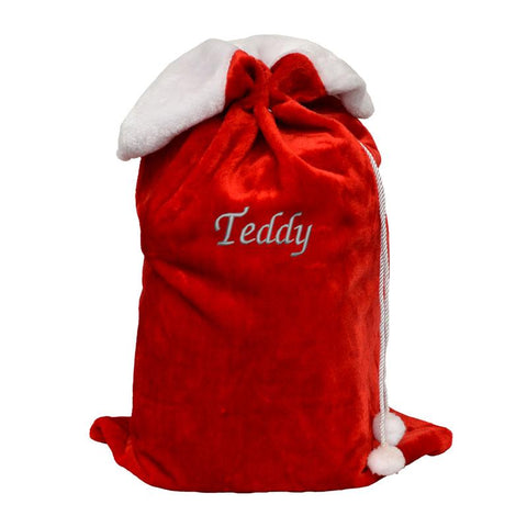 A personalised red and white fluffy Christmas sack with a name embroidered on the front in silver thread