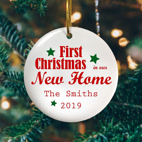 "A personalised ceramic bauble with the message ""First Christmas in our New Home, the Smiths 2018"" printed on it"