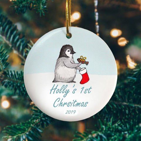 A penguins first Christmas personalised circle bauble