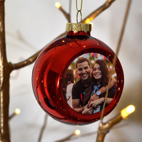 A personalised red photo bauble with a picture of a man and woman printed on it